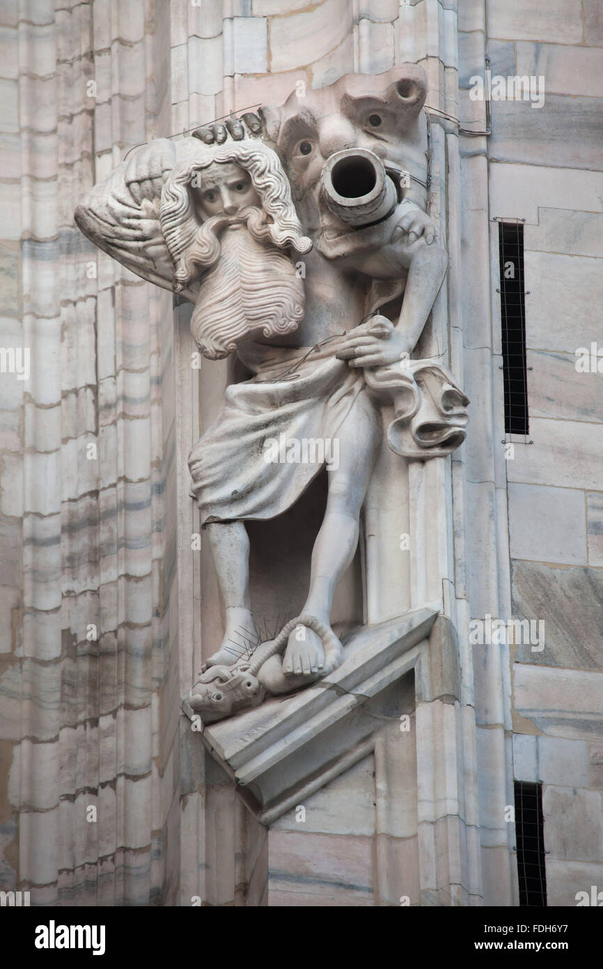 Marble statue of a bearded man on the south facade of the Milan Cathedral (Duomo di Milano) in Milan, Lombardy, - Stock Image