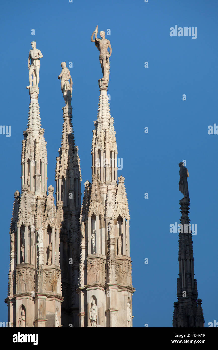 Marble statues of Saints on the spires of the Milan Cathedral (Duomo di Milano) in Milan, Lombardy, Italy. - Stock Image