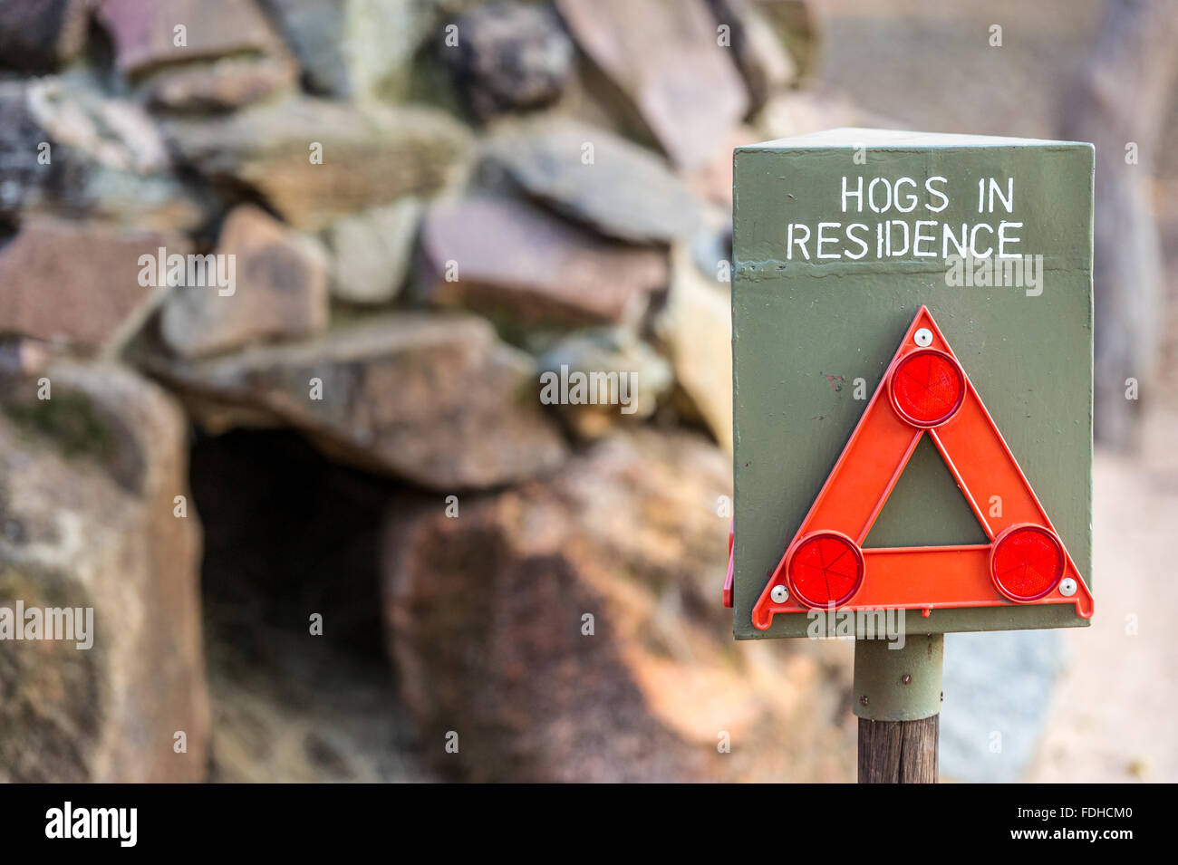 Hogs in Residence warning sign at the Mlilwane Wildlife Sanctuary in Swaziland, Africa. - Stock Image