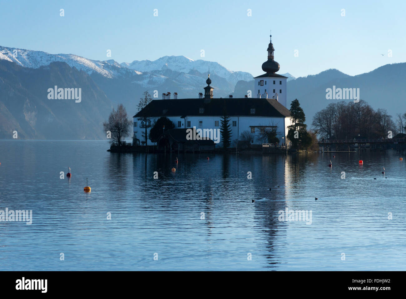 Schloss Ort in Gmunden, Austria, with snow covered mountains in the background - Stock Image