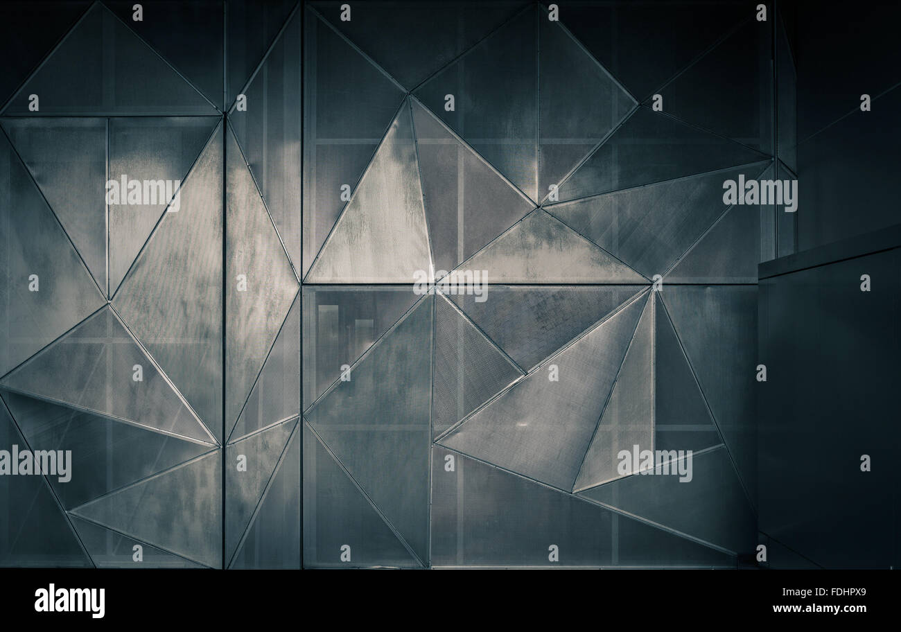 Metal perforated geometric construction combined of many triangles. - Stock Image