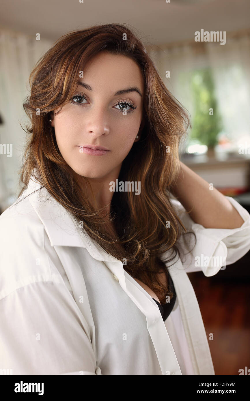 thoughtful girl greets the morning in the living room - Stock Image