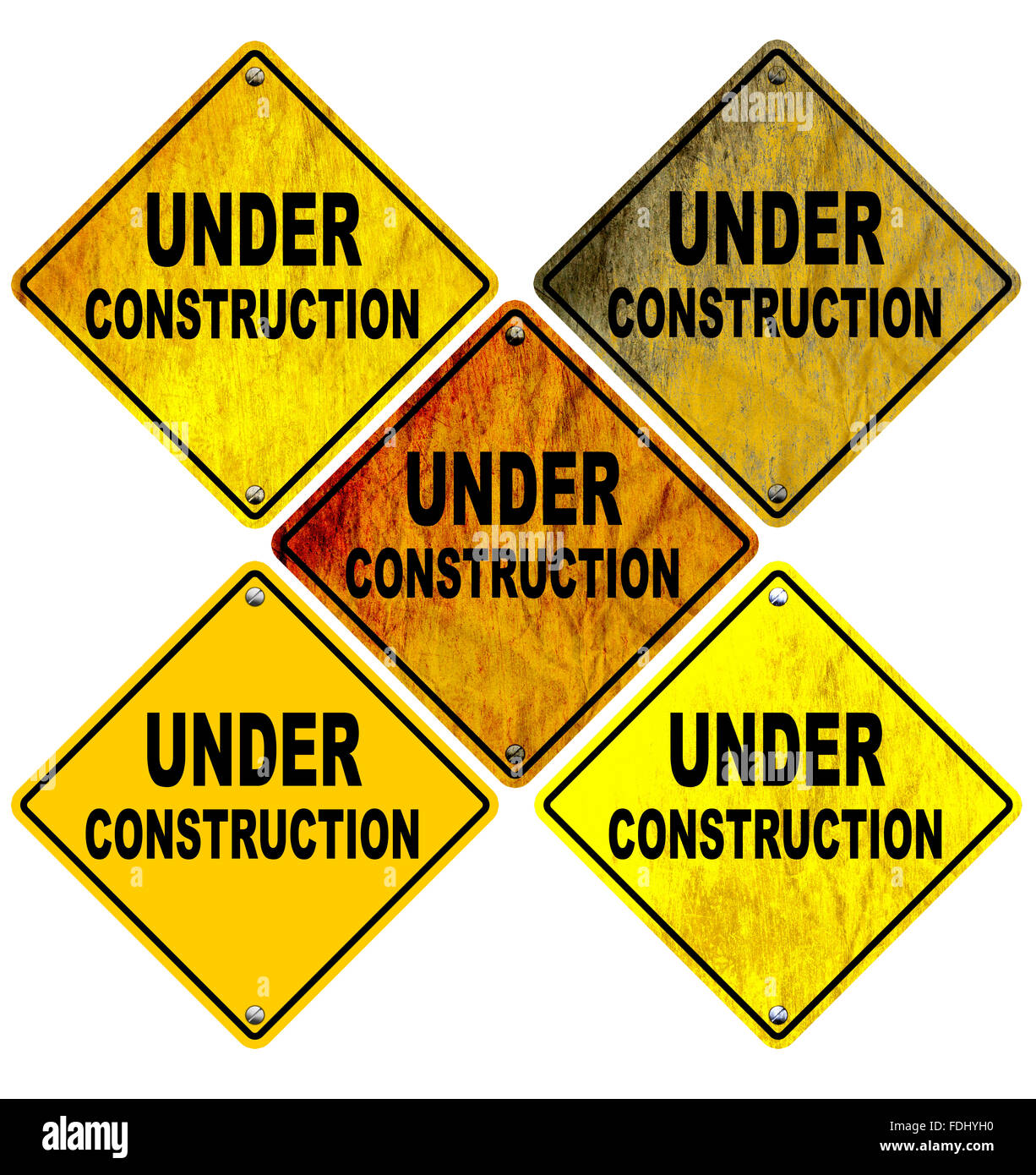 Set of Stained and wrinkled Under Construction Road Signs - Stock Image