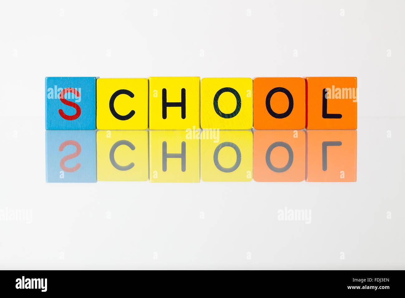 School - an inscription from children's wooden blocks - Stock Image