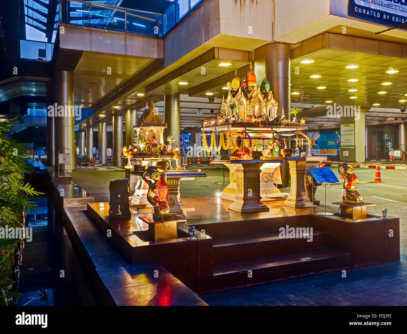 Illuminated shrine at Siam Paragon shopping mall. Bangkok, Thailand. Stock Photo