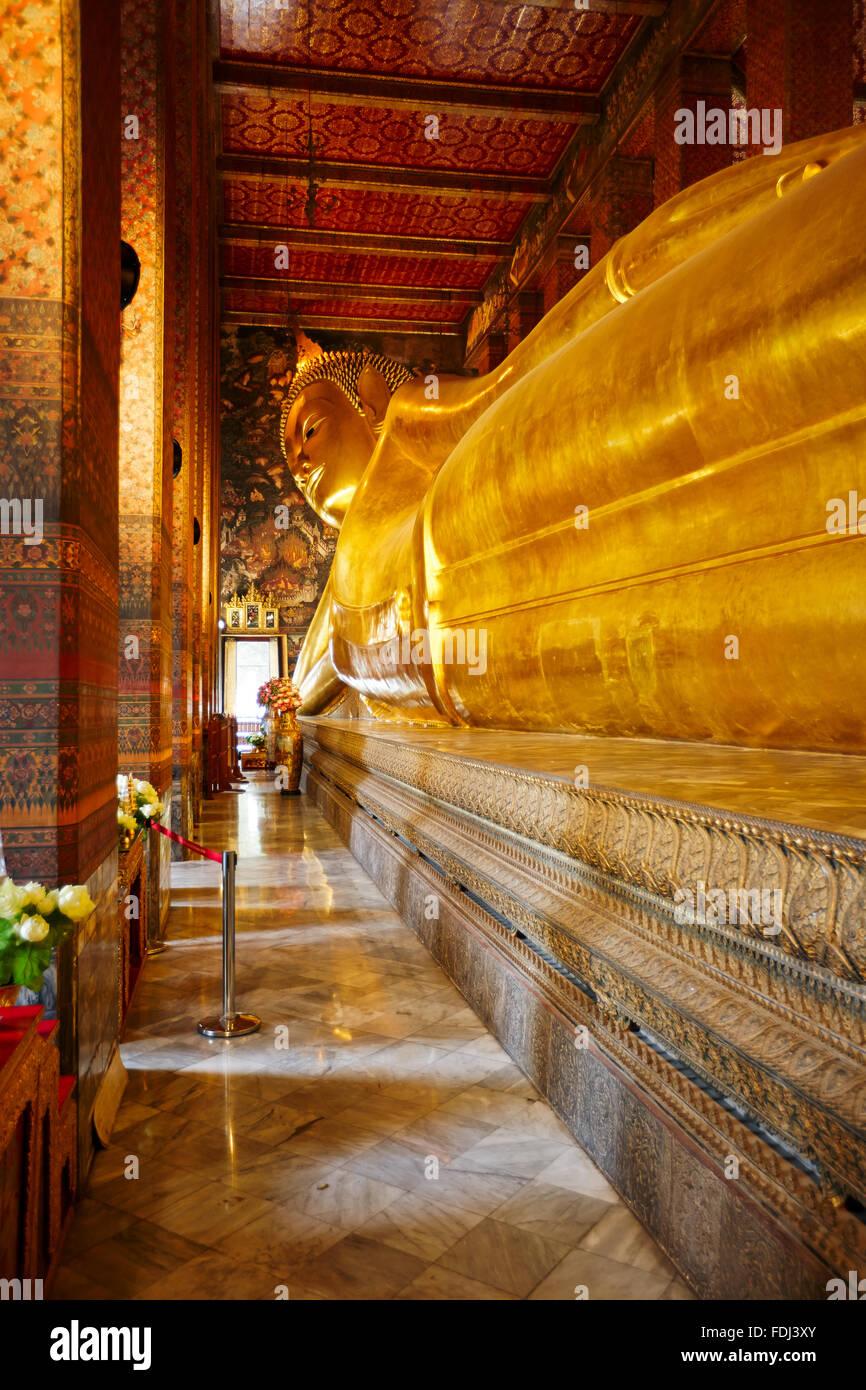 Phra Buddha Saiyas, the Reclining Buddha. Wat Pho Temple, Bangkok, Thailand. - Stock Image