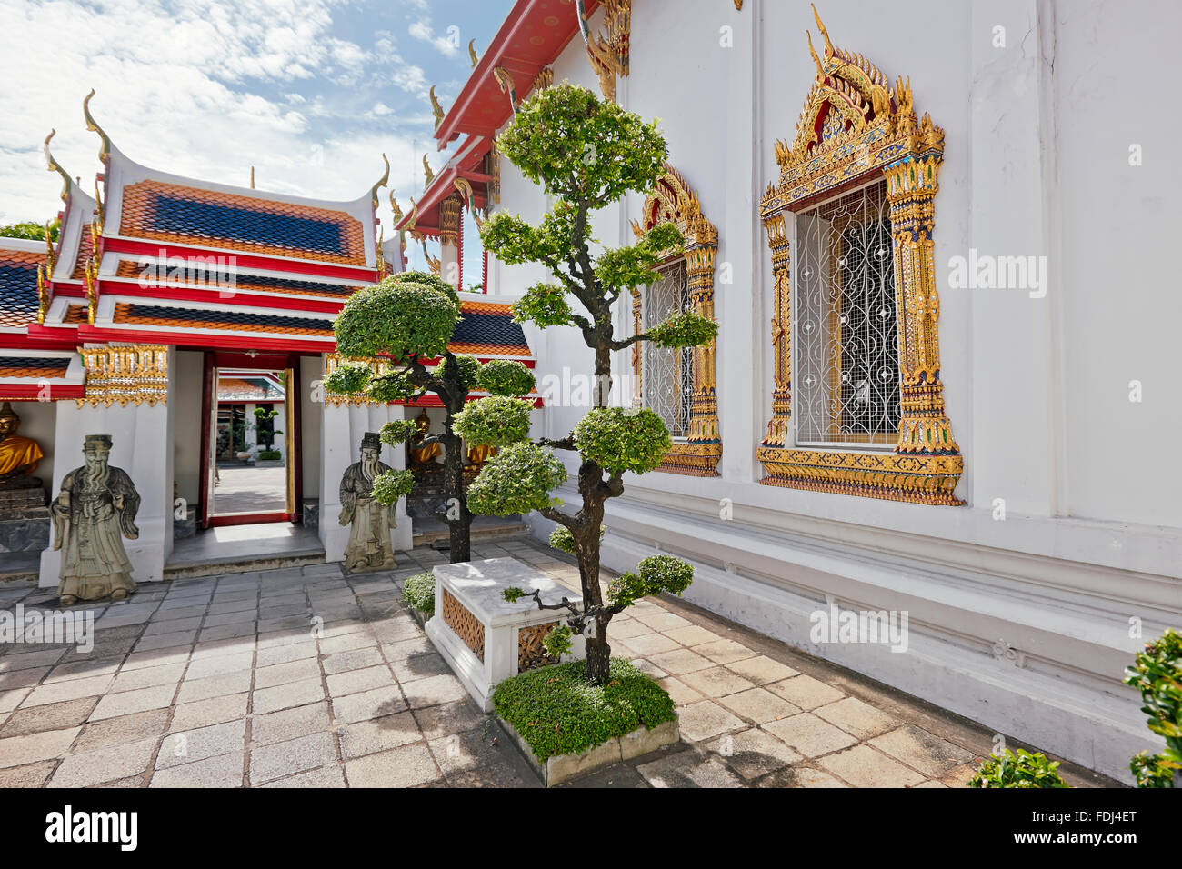 Bonsai trees growing in one of the courtyards of Wat Pho Temple. Bangkok, Thailand. - Stock Image