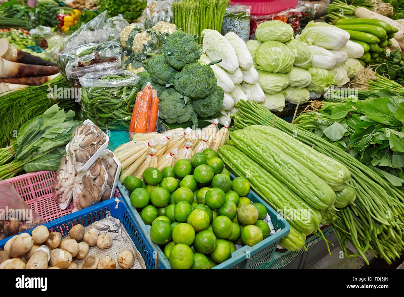 Vegetable stall at Or Tor Kor (OTK) Fresh Market. Bangkok, Thailand. - Stock Image