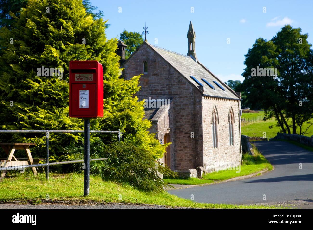 Red post Lamp box on a pole. Blencow, Cumbria, England, United Kingdom. Stock Photo