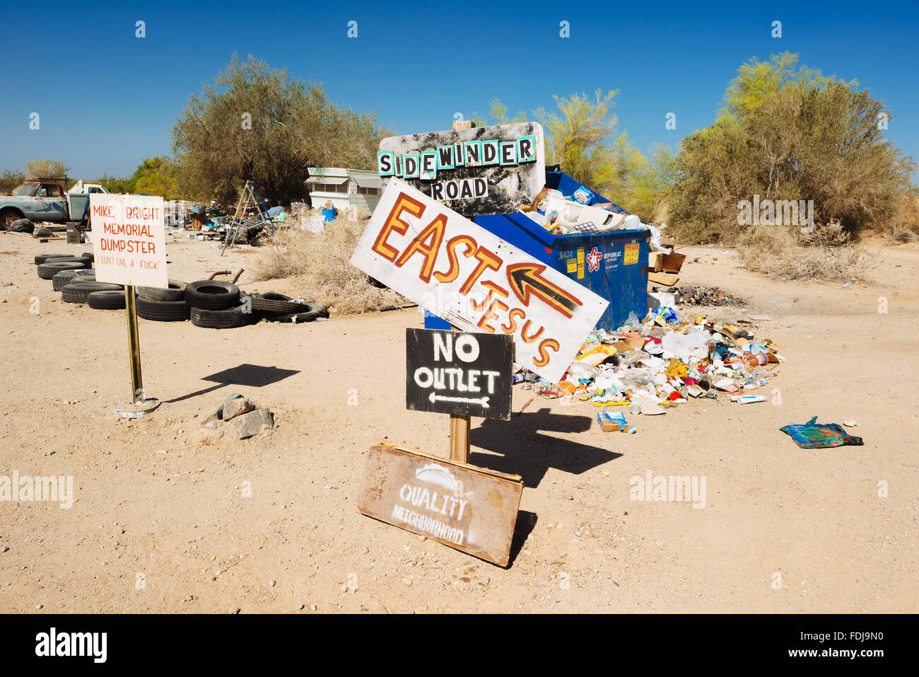 Signs pointing to various points of interest in Slab City, California - Stock Image
