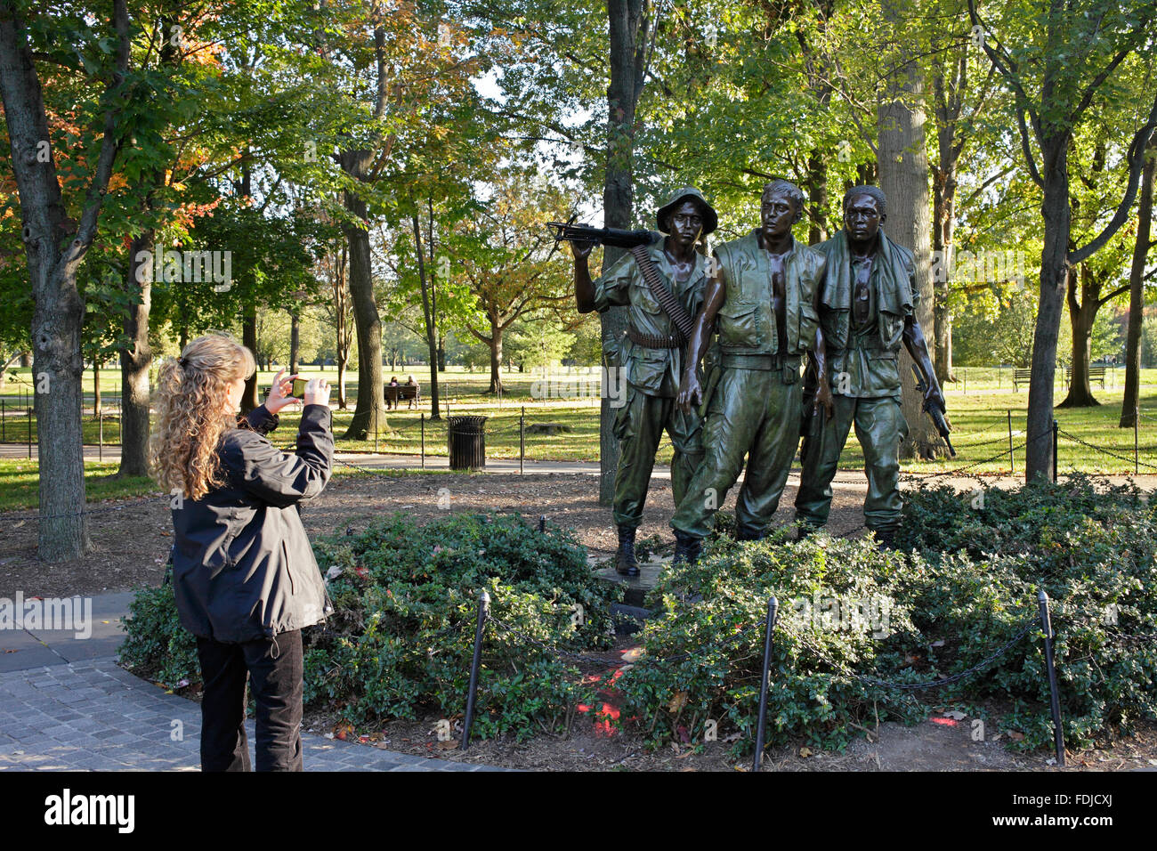 Washington D.C., USA, visitor photographs the sculptural group Three Servicemen - Stock Image