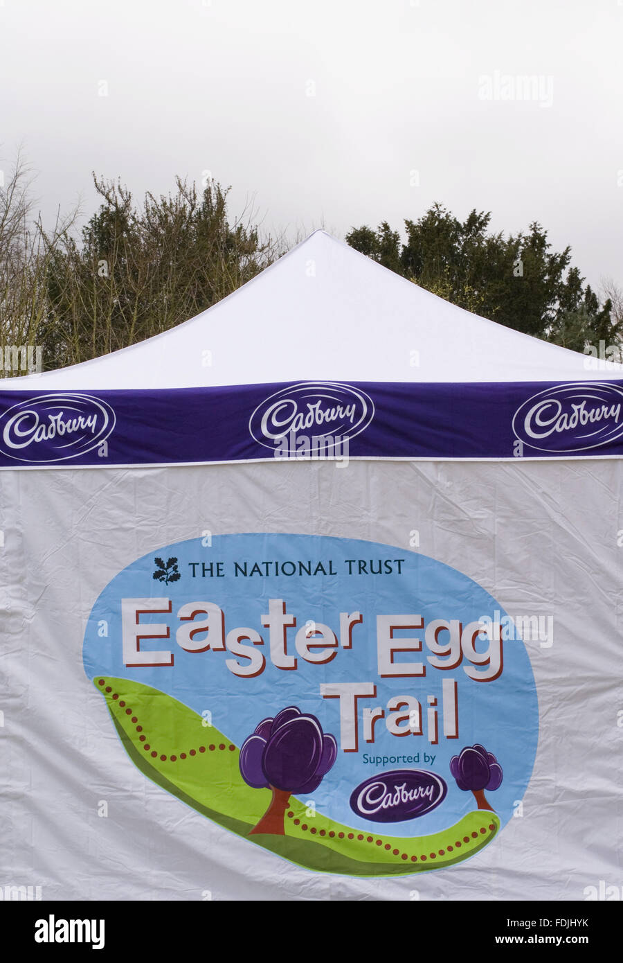 Branded marquee on an Easter Egg Trail, sponsored by Cadbury, at Stowe Landscape Gardens, Buckinghamshire. - Stock Image