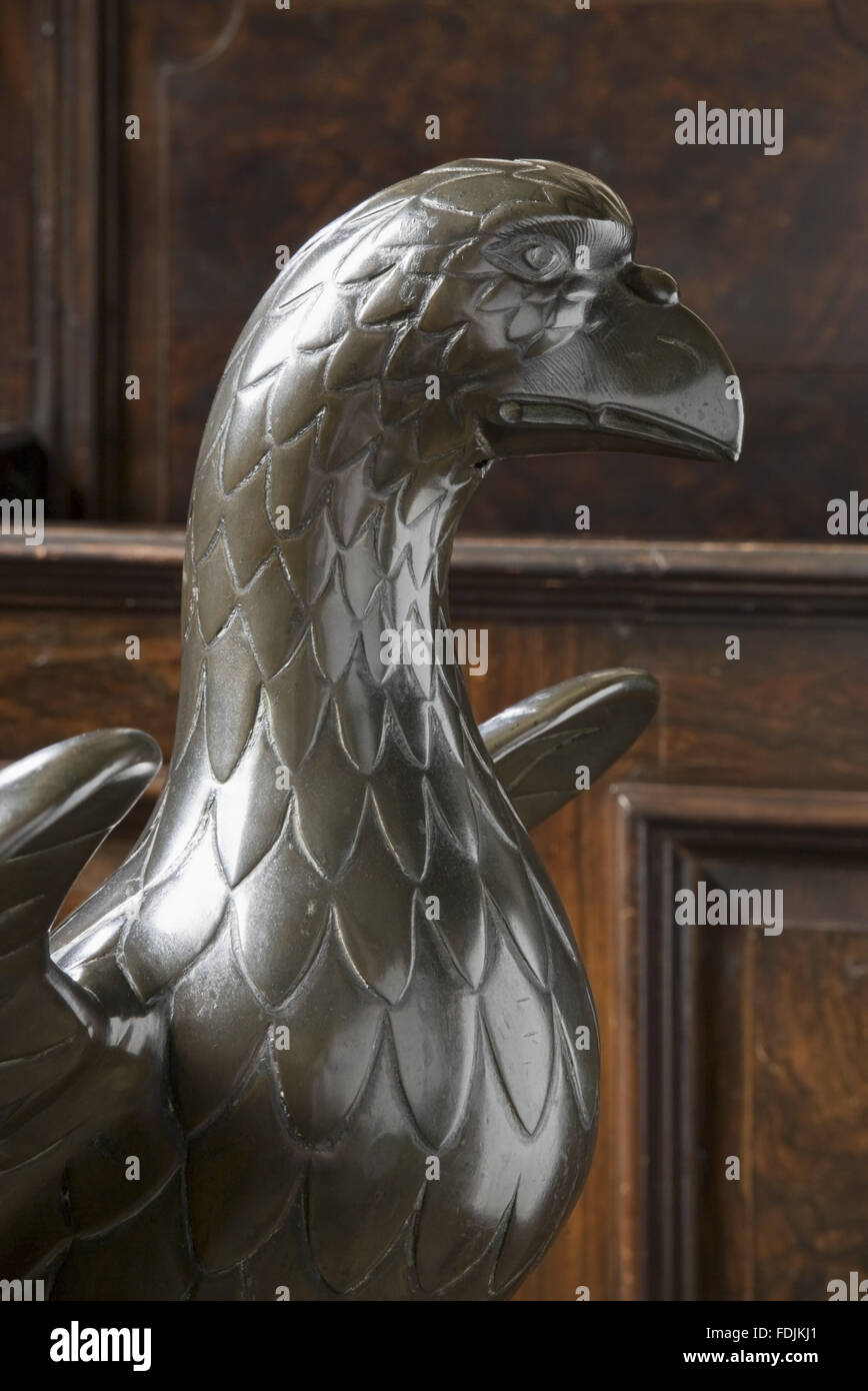 Close view of the head of the bronze eagle lectern c.1500, in the Chapel at Petworth House, West Sussex. - Stock Image