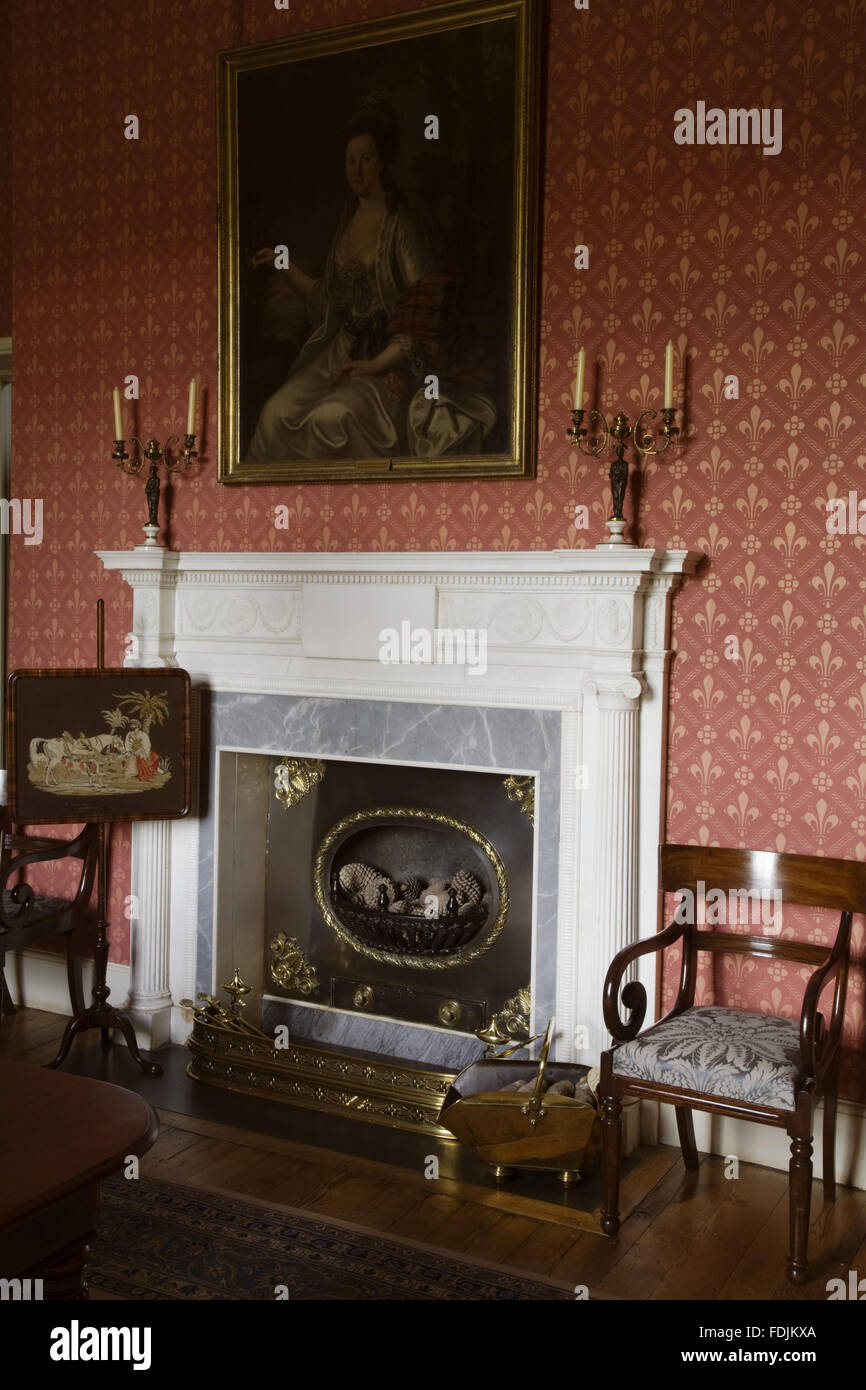 White marble chimneypiece in the Dining Room salvaged from the former house in 1820 at Arlington Court, Devon. Stock Photo