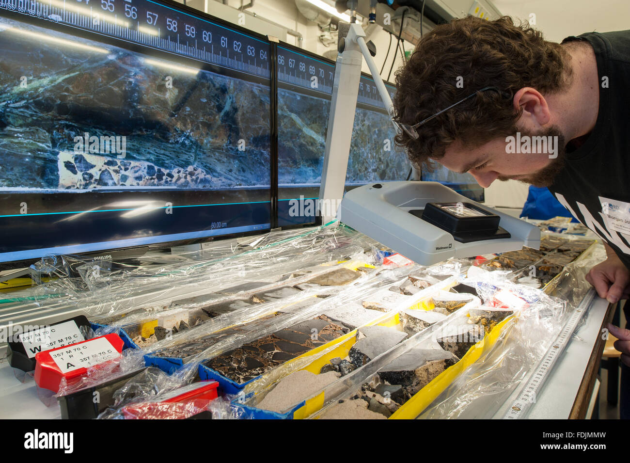 Bremen, Germany. 01st Feb, 2016. Marine scientist John Williams examines a drill core sample from the bottom of - Stock Image