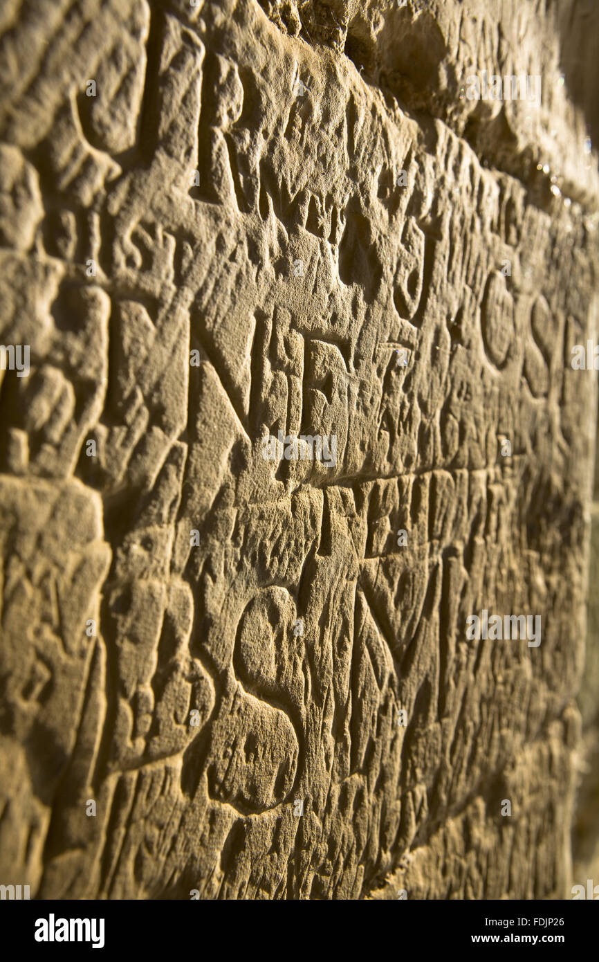 Close View Of Ancient Graffiti Carved Into The Stonework At Bodiam Castle East Sussex