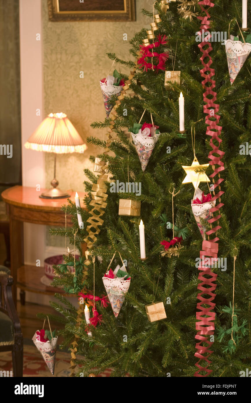 Traditional Victorian Christmas decorations on the tree at Standen ...