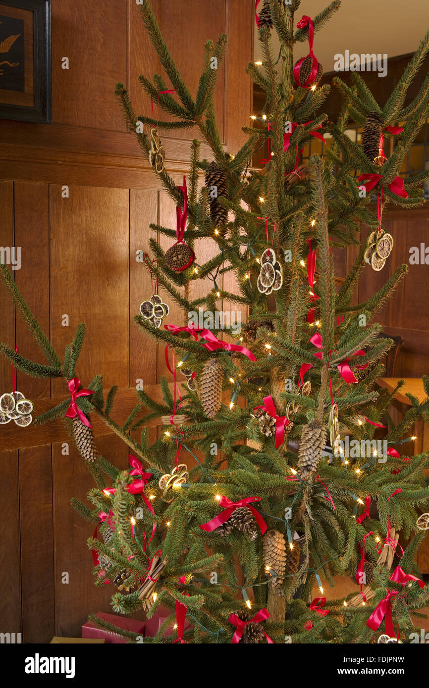 traditional victorian christmas decorations on the tree at standen west sussex stock image