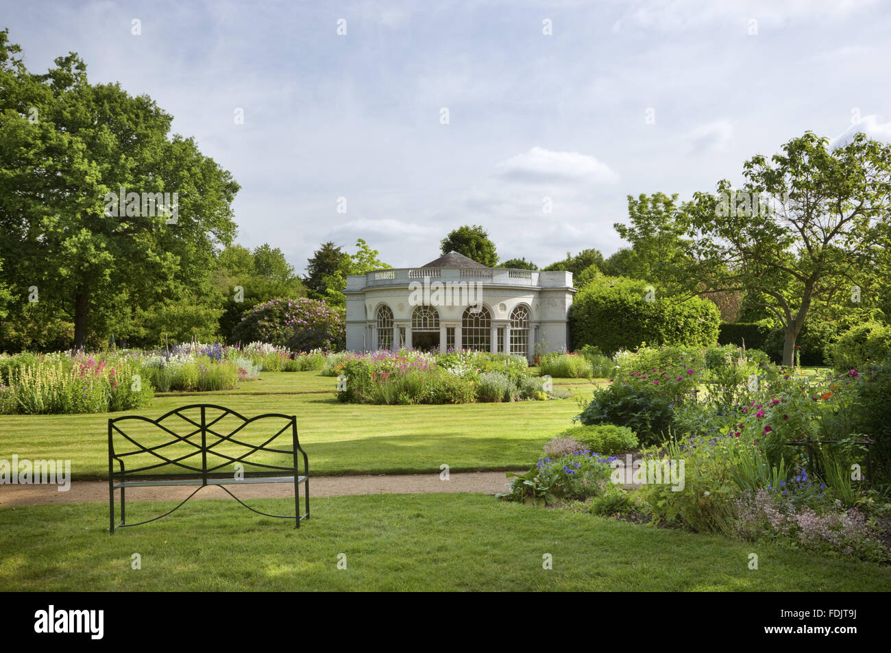The Garden House, built in 1780 by Robert Adam, in the Pleasure Grounds at Osterley, Middlesex. The building has a semicircular front and Ionic pilasters. Stock Photo