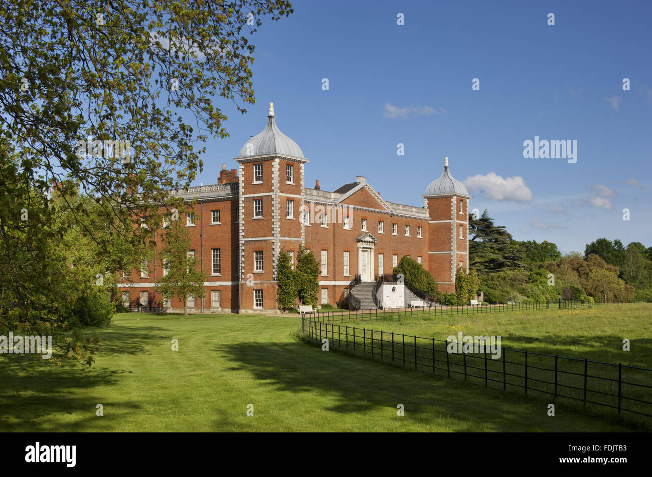 The west or garden front of the house with curved stairs at Osterley, Middlesex. The house was originally Elizabethan, and remodelled in 1760 - 80 by Robert Adam. Stock Photo