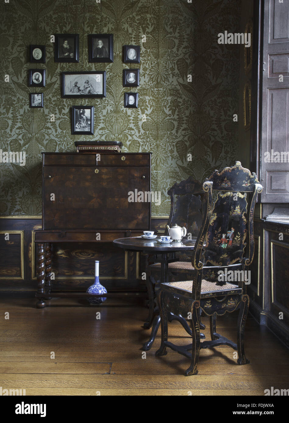 The Duchess's Private Closet with writing-cabinet, tea-table and japanned chairs at Ham House, Richmond-upon - Stock Image