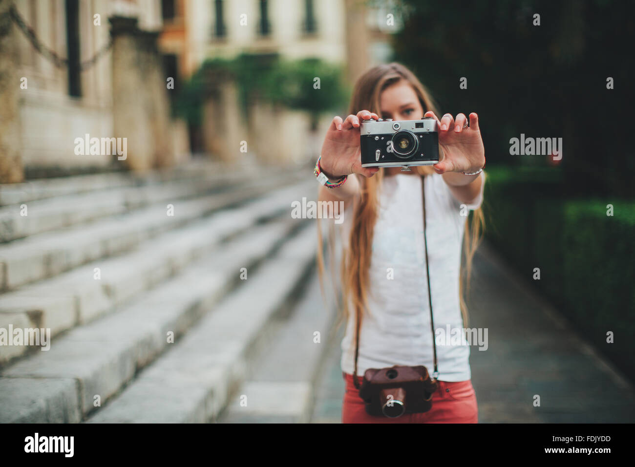 Young woman holding retro film camera, Seville, Spain Stock Photo