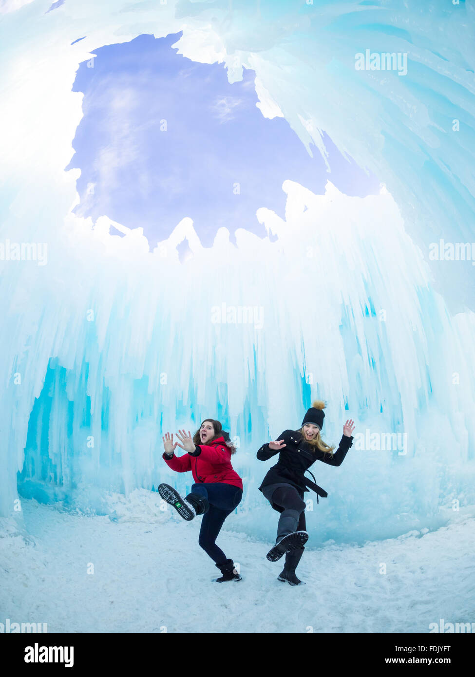 Two girls acting silly under the Dome Room at the Ice Castle in Hawrelak Park, Edmonton, Alberta, Canada. - Stock Image
