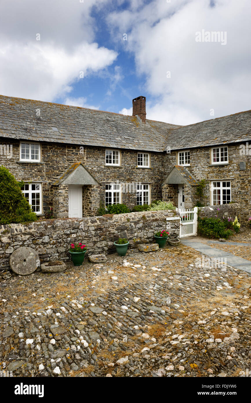 Trevigue Farm, a sixteenth-century farmhouse around a cobbled courtyard, now a National Trust bed & breakfast - Stock Image