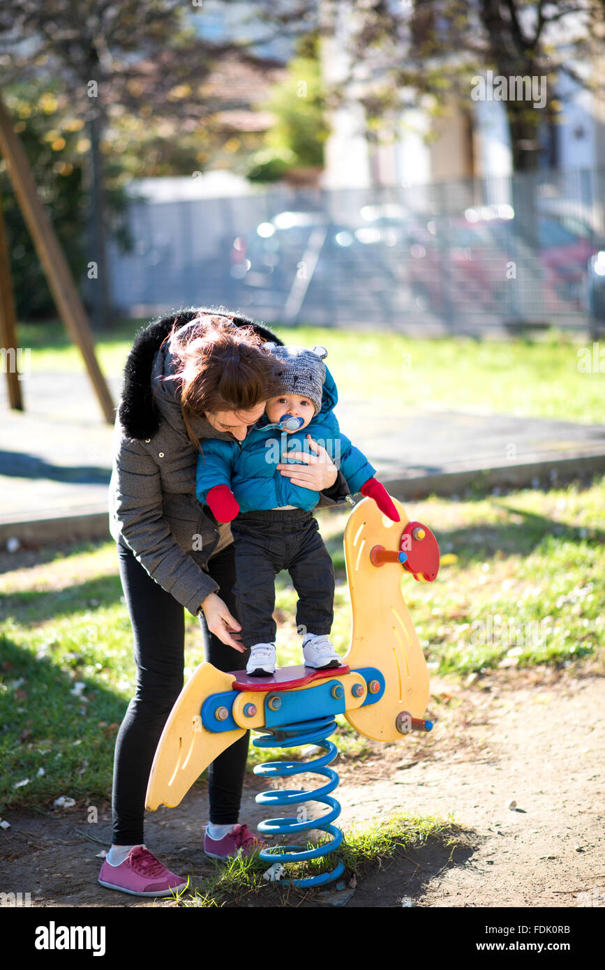 Mother and son playing in a playground Stock Photo