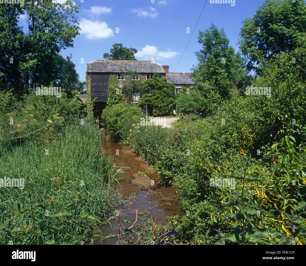 Clyston Mill dates back to the nineteenth century and is a fully working mill producing flour at Broadclyst, Devon. - Stock Image