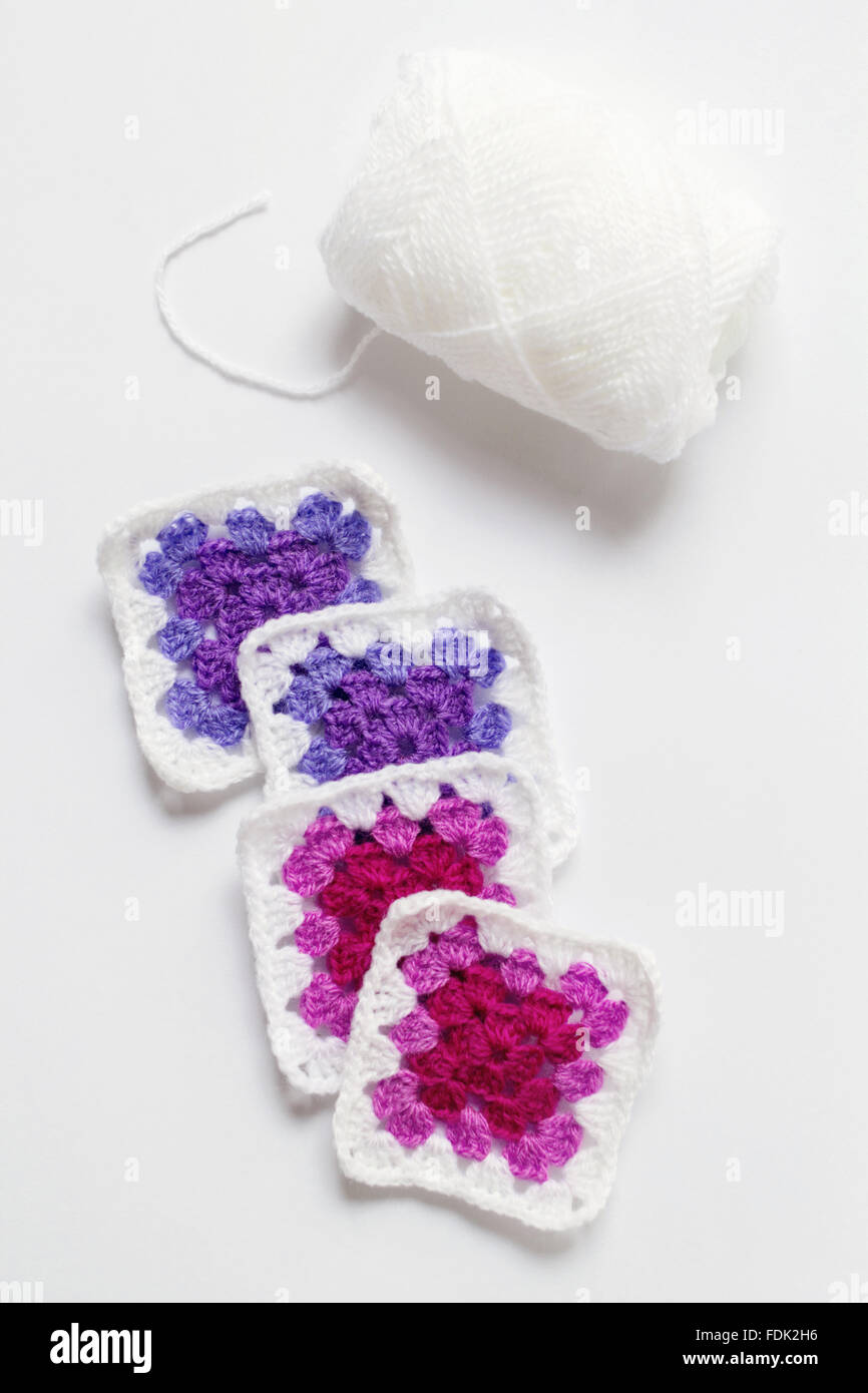 Crocheted doilies and white skein of yarn - Stock Image