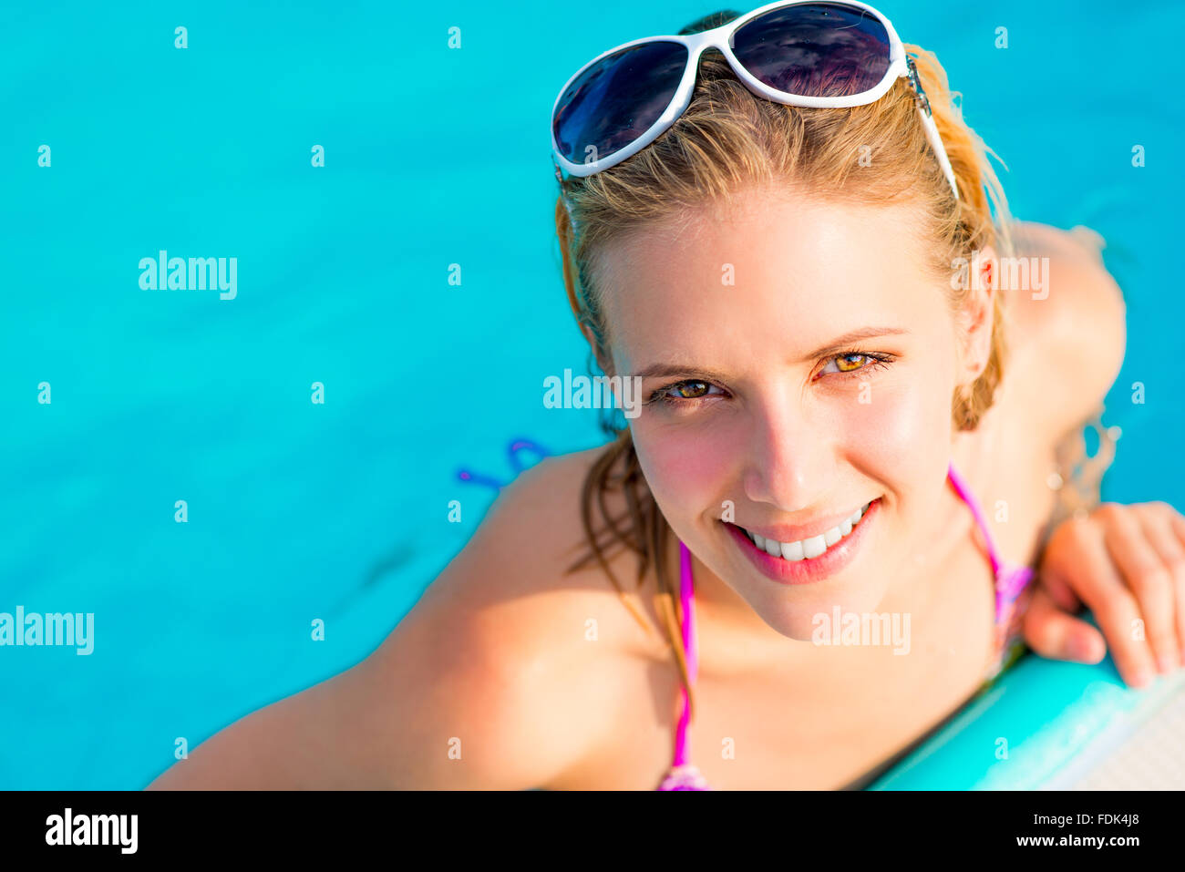 Beautiful young woman in the swimming pool - Stock Image