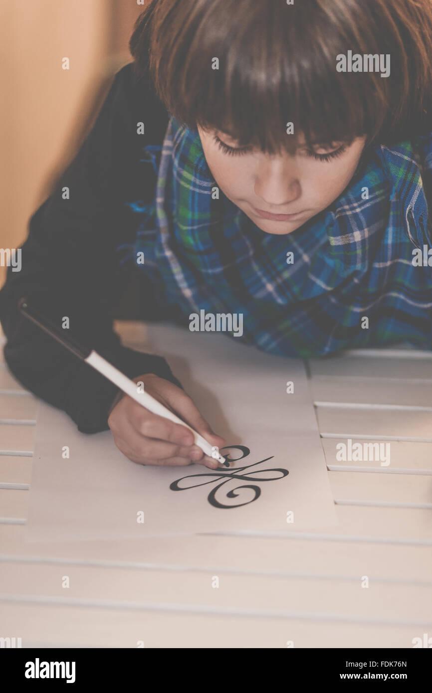 Boy drawing the new beginning symbol - Stock Image