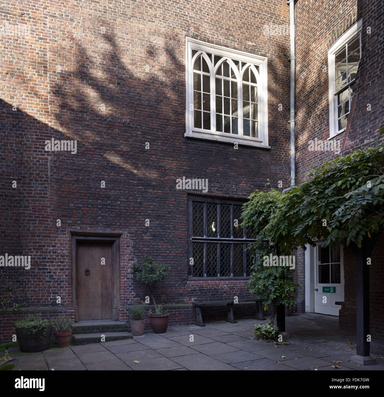 The inner courtyard with the sixteenth-century Armada window, at Sutton House, Hackney, London. - Stock Image
