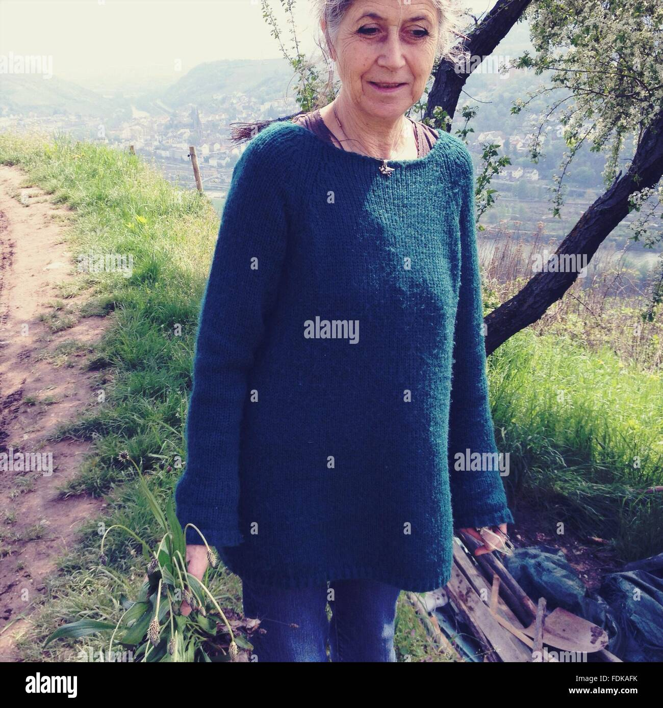 Mature Woman Walking Outdoors - Stock Image