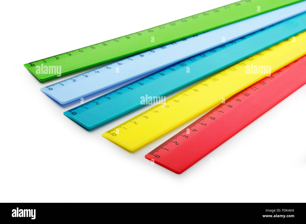 Multicolor plastic rulers on a white background - Stock Image