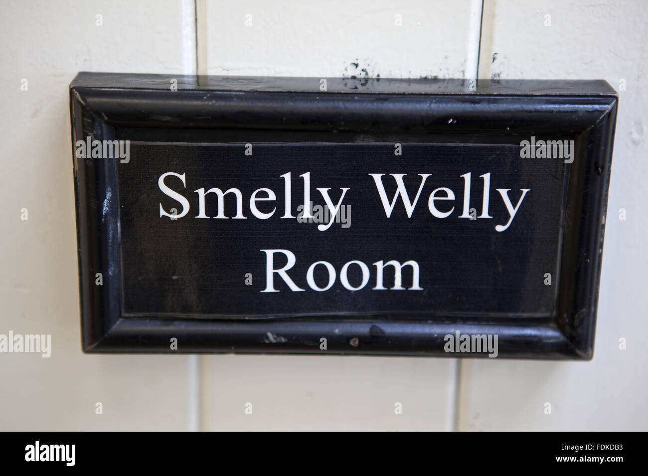 """Sign for the """"Smelly Welly Room"""" at Brancaster Millennium Activity Centre, Norfolk. Stock Photo"""