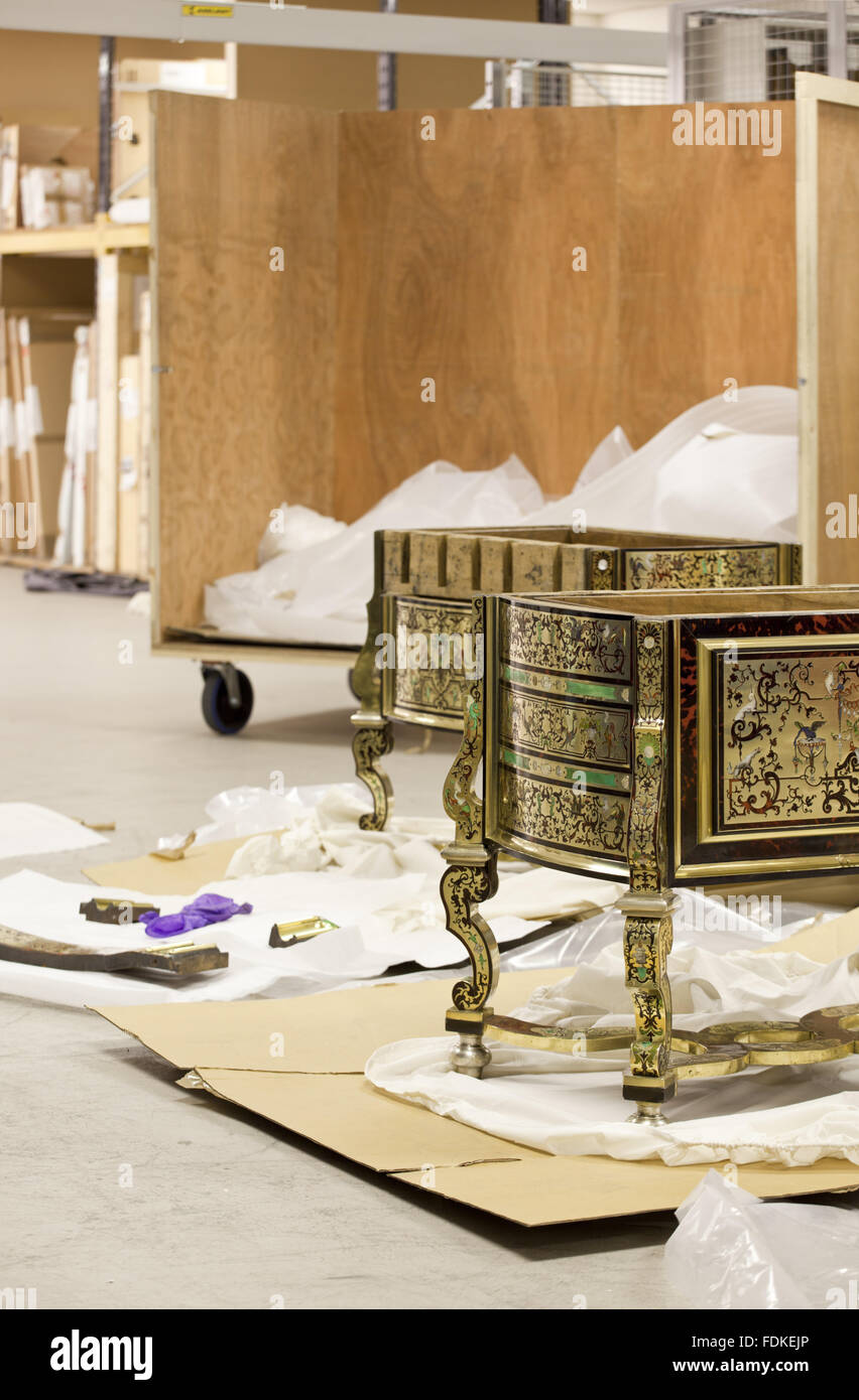 The Saltram bureau or writing table in a dismantled state in the studio storage facility. The Louis XIV writing - Stock Image