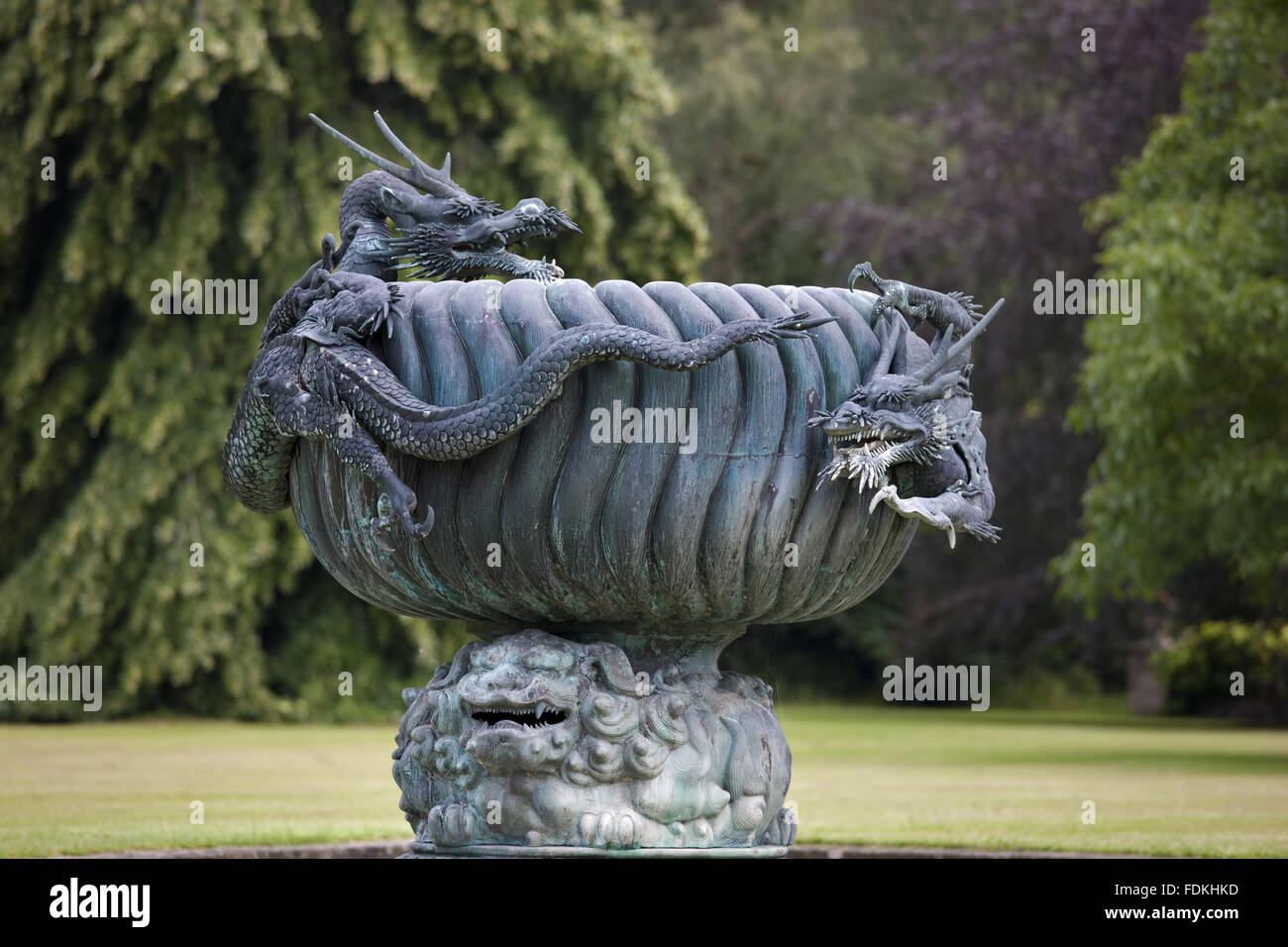 Bronze dragon fountain in the longitudinal canal on the Great Lawn at Dyffryn Gardens, Vale of Glamorgan. - Stock Image
