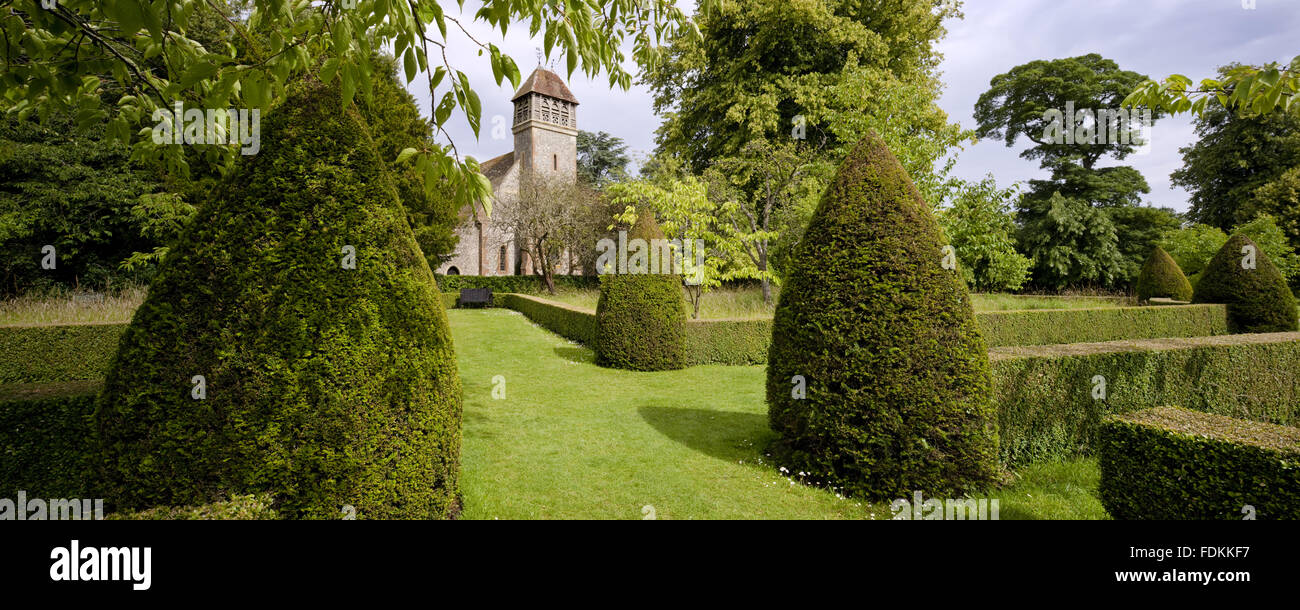 All Saints church (Not National Trust) seen from the Orchard at Hinton Ampner, Hampshire. - Stock Image