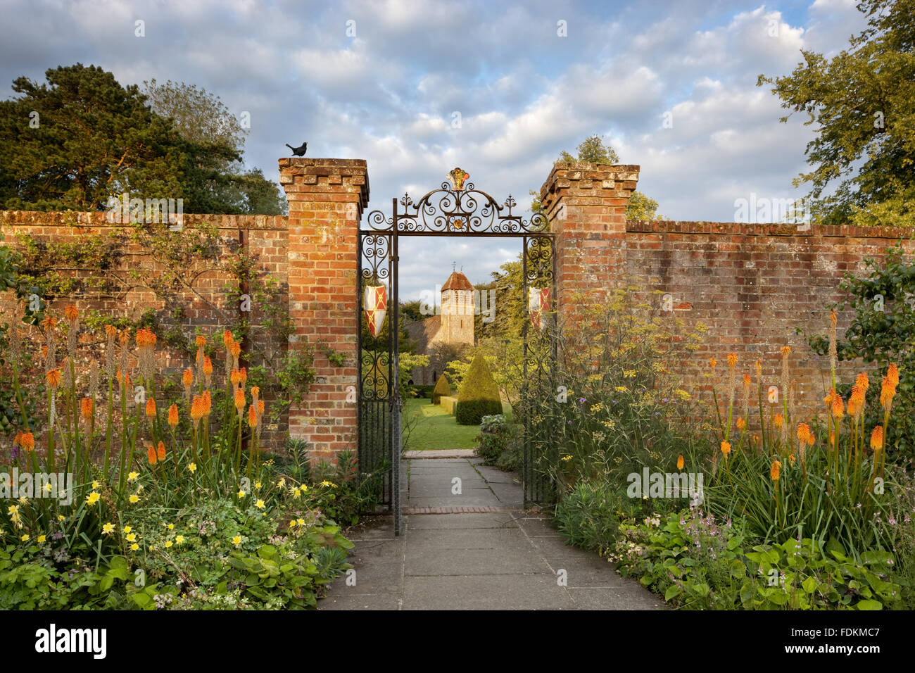 All Saints church (Not National Trust) viewed from the Walled Garden at Hinton Ampner, Hampshire. - Stock Image