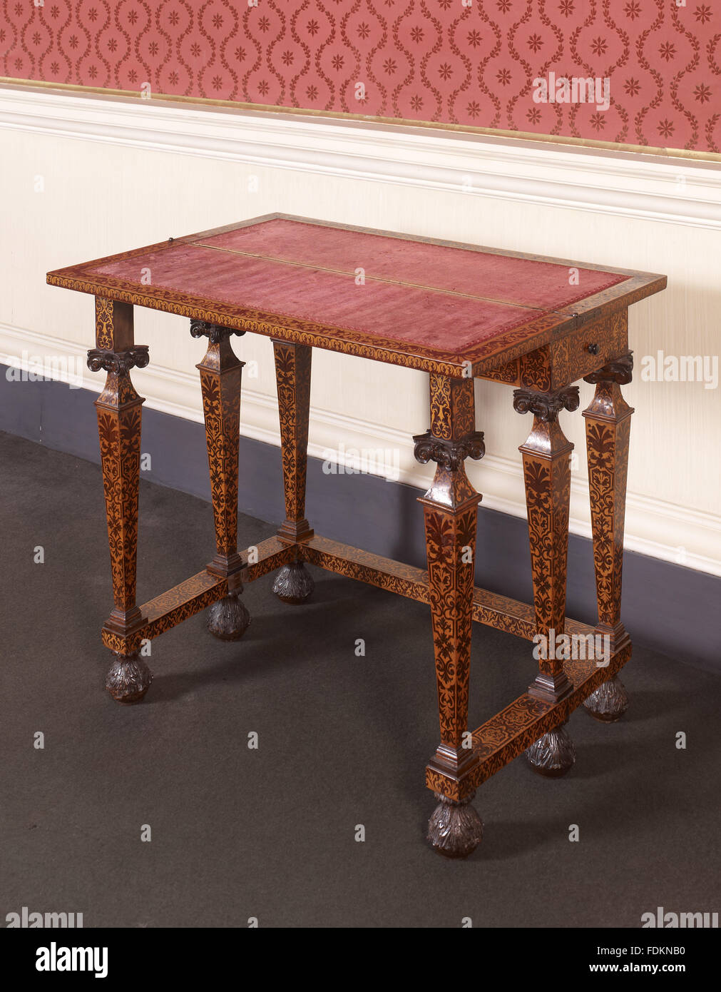 William & Mary marquetry card table with folding top at Clandon Park, Surrey. The table is in the manner of - Stock Image