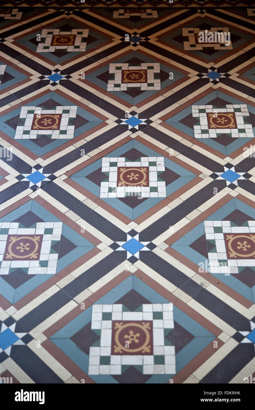Close view of the Maw & Co tiled floor of the Entrance Hall at Sunnycroft, Shropshire. The tessellated tiled - Stock Image