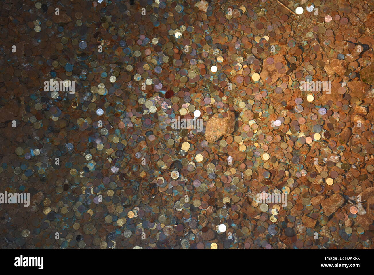 Coins in well of hermitage of Saint Emilion in the town of Saint Emilion, France - Stock Image