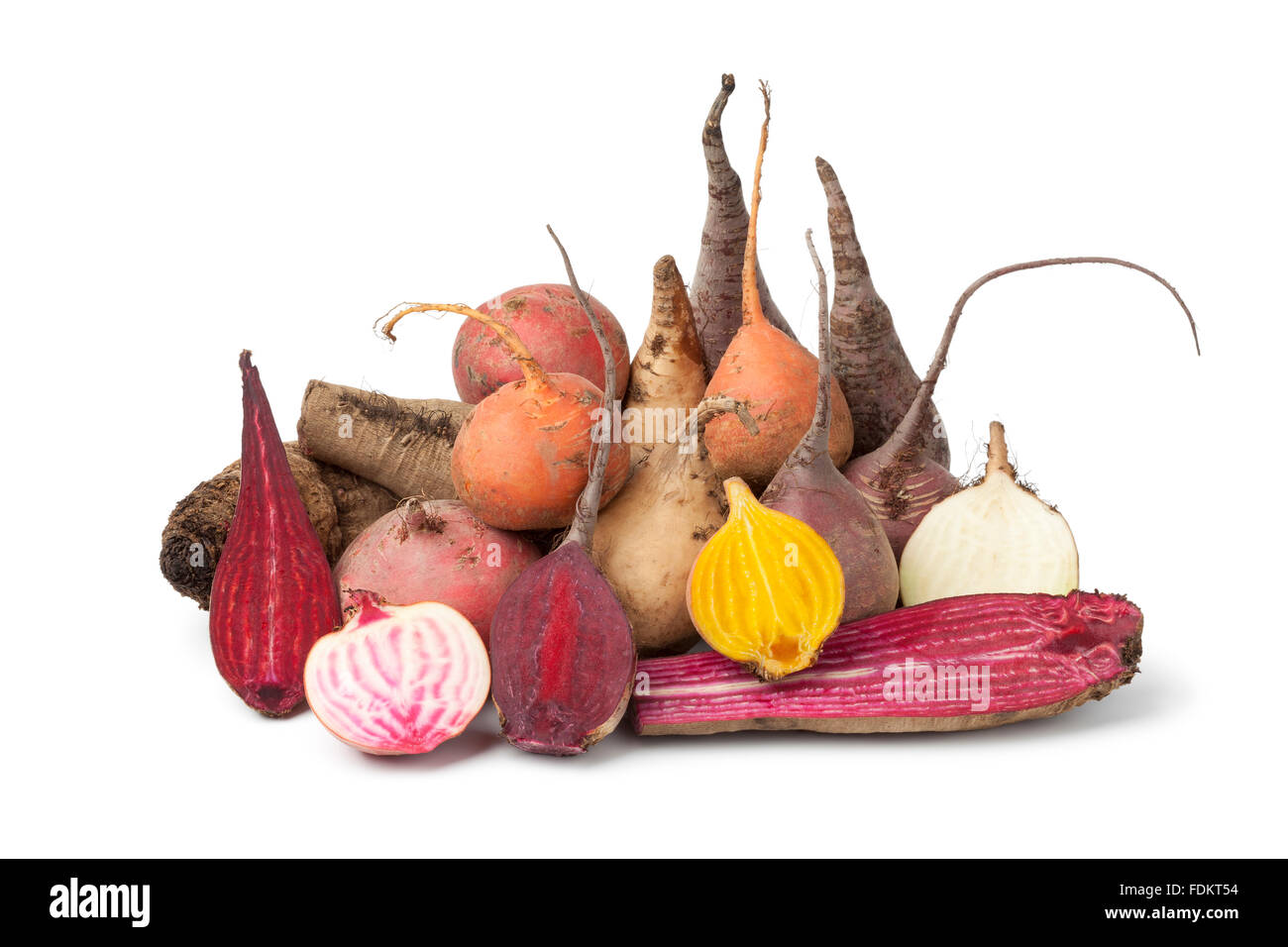 Variety of whole and half multi Colored beets on white background - Stock Image