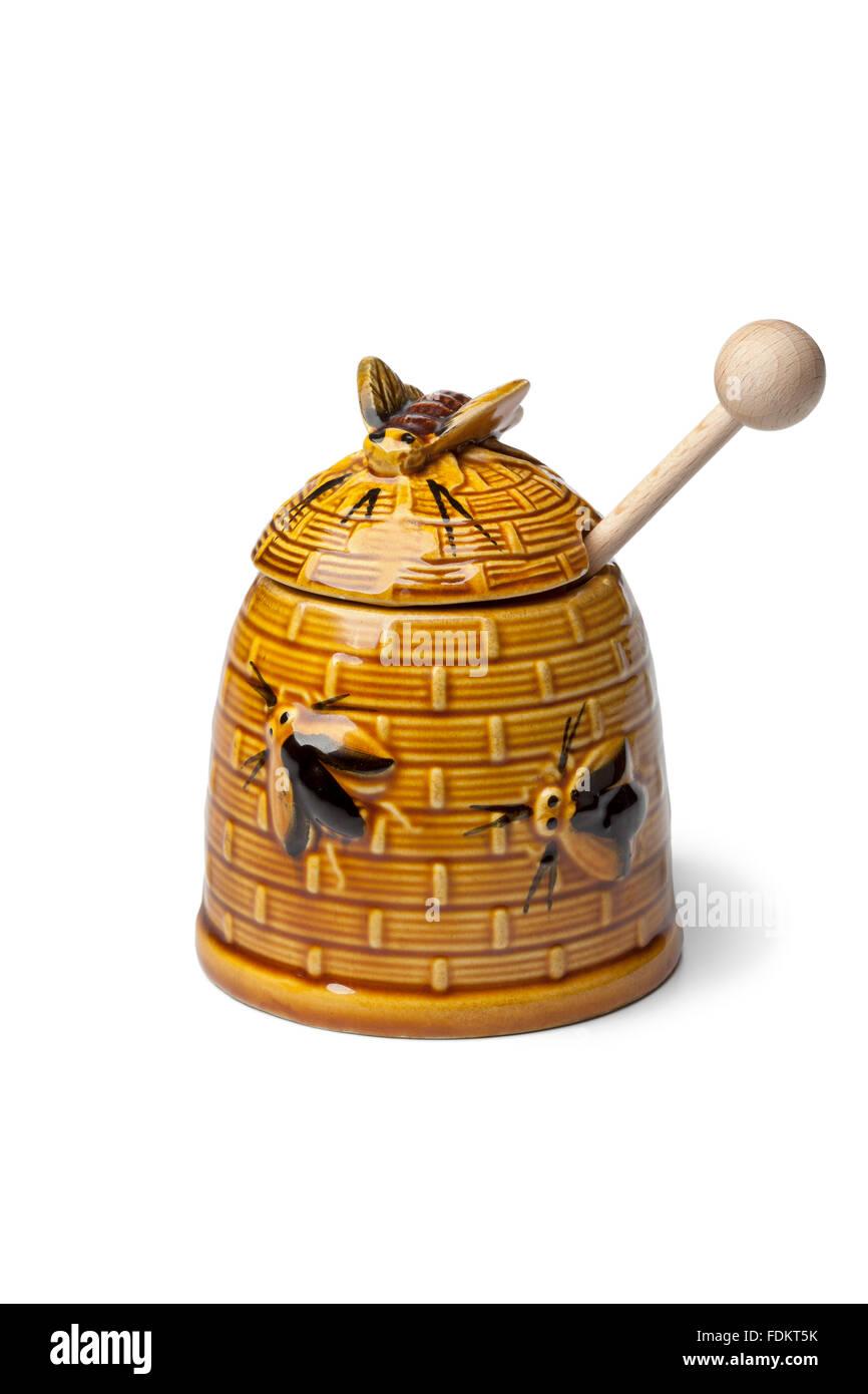 Classic ceramic honey pot on white background - Stock Image