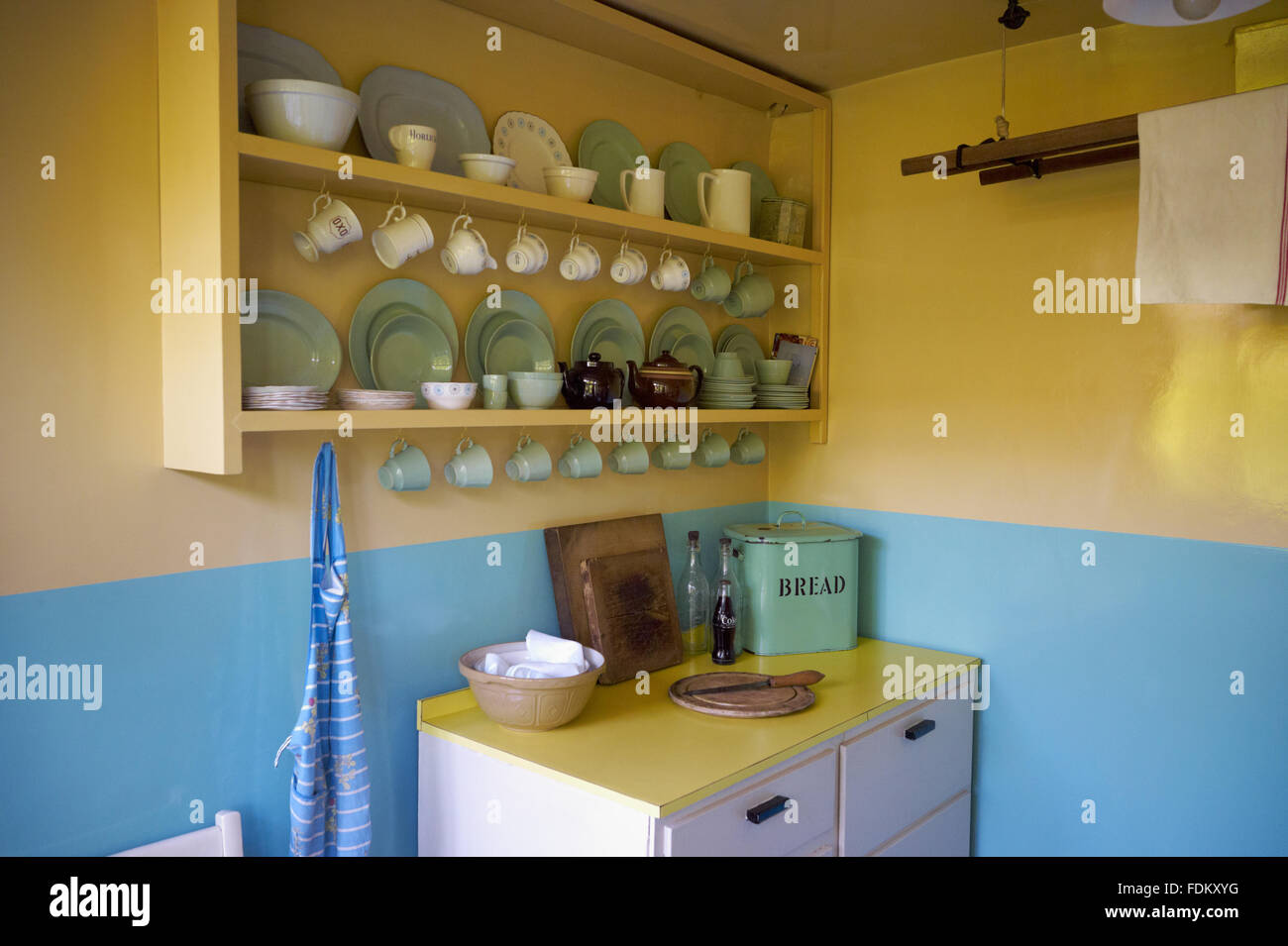 Shelves With Crockery And Cupboard Beneath In The Kitchen At Mendips Stock Photo Alamy