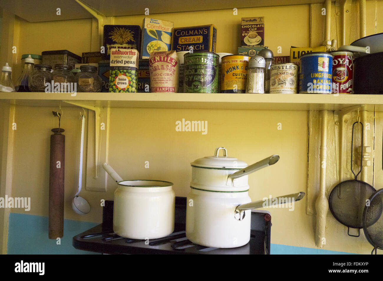 Shelf Above Saucepans On The Cooker In The Kitchen At Mendips The Stock Photo Alamy