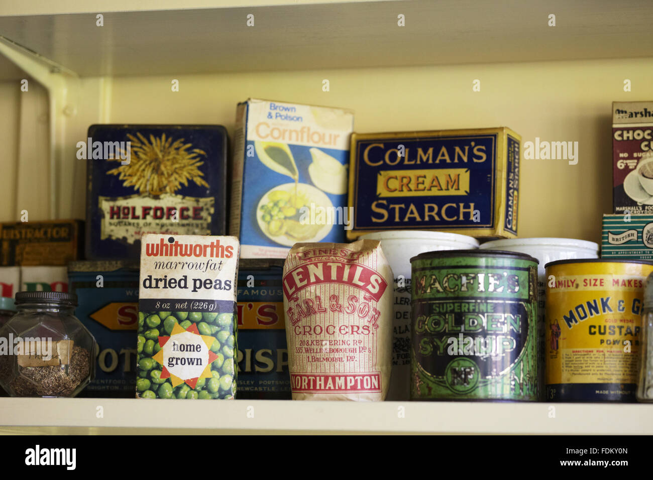 Boxes and tins of provisions in the Kitchen at Mendips, the childhood home of John Lennon, in Woolton, Liverpool. - Stock Image