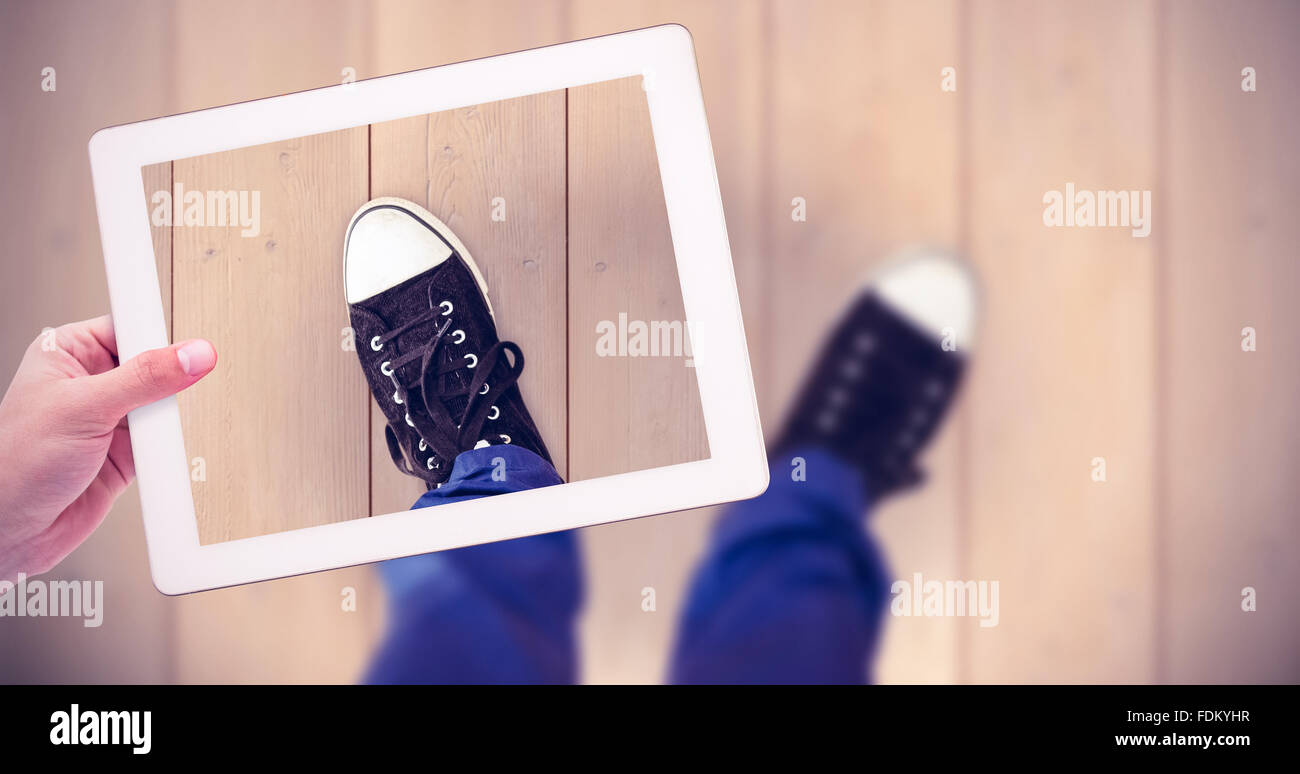 Composite image of masculine hand holding tablet Stock Photo